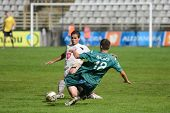 KAPOSVAR, HUNGARY - JULY 30: Benjamin Balazs (in green 18) in action at a Hungarian National Championship soccer game - Kaposvar (green) vs Videoton (white) on July 30, 2011 in Kaposvar, Hungary.