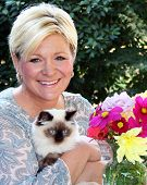 image of middle-age  - a middle aged woman with her kitten - JPG