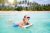 Kids Surf On Tropical Beach. Vacation With Child. poster