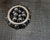 Antique Automotive Vintage Wheel Bearing With Loose Ball Bearings On Plain Weave Carbon Fiber poster