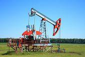 Oil Pump Jack In A Field