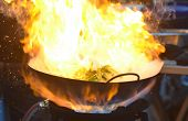 Burning Flame Over The Pan When Chef Cooking A Stir Fried Swamp Cabbage/water Spinach poster