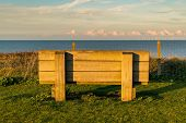 A Large Bench With A View Over The North Sea And Some Wind Turbines, Seen At Botany Bay In Kingsgate poster