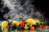 Closeup Shot Of Steamed Vegetables On Tray With Steam. poster