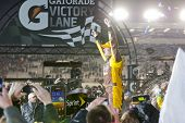 RICHMOND, VA - APRIL 28:  Kyle Busch (18) holds off a hard charging field to win the Capital City 40