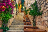 Cozy Narrow Street With Street Cafe And Restaurant At Morning. Rustic Street With Stone Houses And C poster
