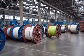Several Rows Of Large, Heavy Metal Coils With Electrical Cables And Wires In Production. Modern Line poster