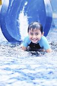 Happy Asian Kid On Water Slide