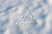 Background Of Christmas Tree Painted On White Snow. Copy Space. Hand Christmas Tree Drawing On Snow. poster