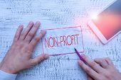 Text Sign Showing Non Profit. Conceptual Photo Type Of Organization That Does Not Earn Profits For I poster