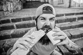 Snack For Good Mood. Guy Eating Hot Dog. Street Food Concept. Man Bearded Eat Tasty Sausage And Drin poster