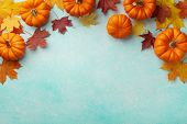 Autumn Thanksgiving Background. Pumpkins And Maple Leaves On Turquoise Table Top View. poster