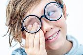 A Fashionable Boy In Round Glasses With Thick Lenses Rubs His Eyes. Childrens Eyesight. Adolescent  poster
