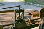 Blacksmiths Clamp. Metal Clamping Device On An Old Workbench. Vise Desktop poster