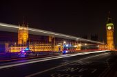 Police, ambulance emergency vehicles at night on Westminster Bridge by Big Ben, Houses of Parliament poster