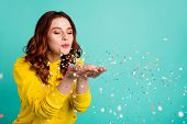 Photo Of Curly Wavy Trendy White Cheerful Charming Sweet Pretty Youngster Blowing Confetti Away From poster