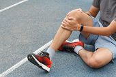 Close Up Of Sport Man Suffering With Pain On Sports Running Knee Injury After Running.injury From Wo poster