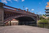 View Of An Old Cast Iron Road Bridge Over The Aire And Calder Navigation In Central Leeds From The P poster