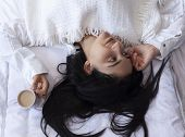 Beauty Woman Drinking Coffee In Bed After Waking Up In Morning. Young Beautiful Woman In Bed With Cu poster