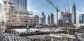 Laborers Working On Modern Constraction Site Works In Dubai. Fast Urban Development Consept poster