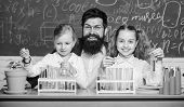 Man Bearded Teacher Work With Microscope And Test Tubes In Biology Classroom. School Biology Experim poster
