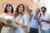 Happy Group Of Friends Tourists Sightseeing In City On Vacation poster