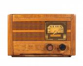 Antique art deco wooden radio from the 1920's isolated on white.
