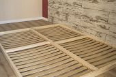 Furniture Planks On The Bottom Of Double Floor Bed. Natural Wooden Planks poster
