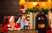 Santa Claus Coming. Family Holiday. Mother And Little Child Boy Adorable Friendly Family Having Fun. poster