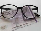 Investment And Promotion For A Better Vision, Danish Banknote And Black Plastic Frame Glasses poster