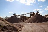 A String Of Transport Belting In A Gravel Pit For Transporting Gravel And Sand Over Long Distances. poster