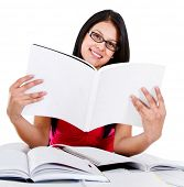 Female student reding a book - isolated over a white background