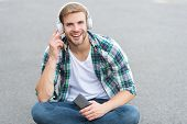 Audio Library. Another Way Of Learning. Man Handsome College Student Headphones. Online Learning. Au poster