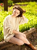 Beautiful woman in stocking sweater on spring nature