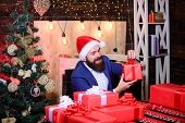Man Bearded Santa Prepared Christmas Gifts. Businessman Near Christmas Tree Wrapping Presents Or Gif poster