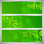 Website header or banner set for St. Patrick's Day celebration with shamrock leaves