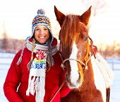pic of winter sport  - Young happy smiling woman with horse - JPG