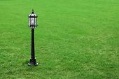 Metal Black Street Lamp On Green Grass