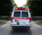 image of infirmary  - a photo of an ambulance in route to an emergency - JPG