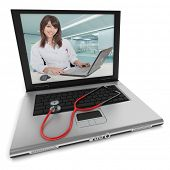 Open laptop with a female health professional on the screen, and a stethoscope on top of the keyboar