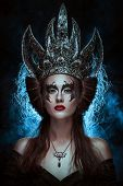 pic of evil queen  - Elegant queen female face with red lips and black eye makeup - JPG