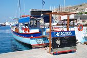 SYMI, GREECE - JUNE 18: Excursion boat Diagoras displays a strike sign in Yialos harbour on June 18,