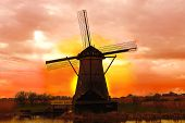 Windmill At Sunset. Dutch Landscape