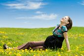 Pregnant Woman On Green Grass