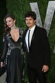 WEST HOLLYWOOD, CA - FEB 24: Miranda Kerr, Orlando Bloom at the Vanity Fair Oscar Party at Sunset To