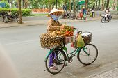 HO CHI MINH CITY, VIETNAM - JANUARY 5: An unidentified seller of fruits sells her  merchandise from