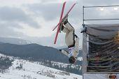BUKOVEL, UKRAINE - FEBRUARY 23: David Morris, Australia performs aerial skiing during Freestyle Ski World Cup in Bukovel, Ukraine on February 23, 2013.