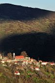 Shadows From The Clouds And Bright Sun Over The Village