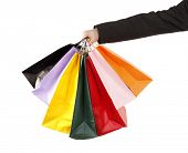 Man is holding colorful shopping bags