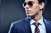 Portrait of calm man in sunglasses posing for camera